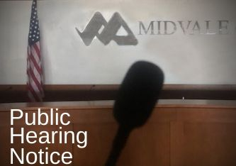 Public Hearing Notice  with microphone and flag in background